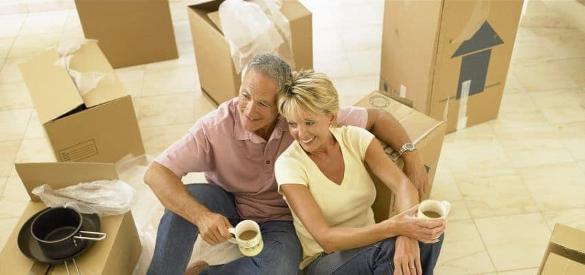 packing services Arlington - a couple with moving boxes