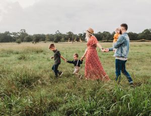 A family walking throught the Palm Beach County areas.