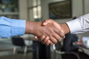 A handshake with professionals who can help you to move your service-based business from Texas to New Hampshire